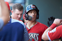 Ryan Aguilar (11) of the Carolina Mudcats is congratulated by teammates after hitting a home run against the Winston-Salem Dash at BB&T Ballpark on June 1, 2019 in Winston-Salem, North Carolina. The Mudcats defeated the Dash 6-3 in game one of a double header. (Brian Westerholt/Four Seam Images)