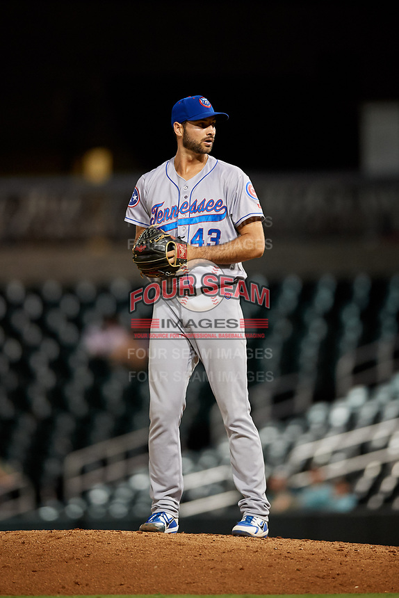 Tennessee Smokies relief pitcher Jake Stinnett (43) gets ready to deliver a pitch during a game against the Birmingham Barons on August 16, 2018 at Regions FIeld in Birmingham, Alabama.  Tennessee defeated Birmingham 11-1.  (Mike Janes/Four Seam Images)