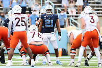 CHAPEL HILL, NC - OCTOBER 10: Chazz Surratt #21 of North Carolina looks over the line of scrimmage during a game between Virginia Tech and North Carolina at Kenan Memorial Stadium on October 10, 2020 in Chapel Hill, North Carolina.