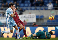 Calcio, Serie A: Lazio vs Roma. Roma, stadio Olimpico, 4 dicembre 2016.<br /> Roma's Kevin Strootman, center, kicks to score as Lazios' Stefan Radu, left, and goalkeeper Federico Marchetti try to stop him during the Italian Serie A football match between Lazio and Rome at Rome's Olympic stadium, 4 December 2016. Roma won 2-0.<br /> UPDATE IMAGES PRESS/Isabella Bonotto