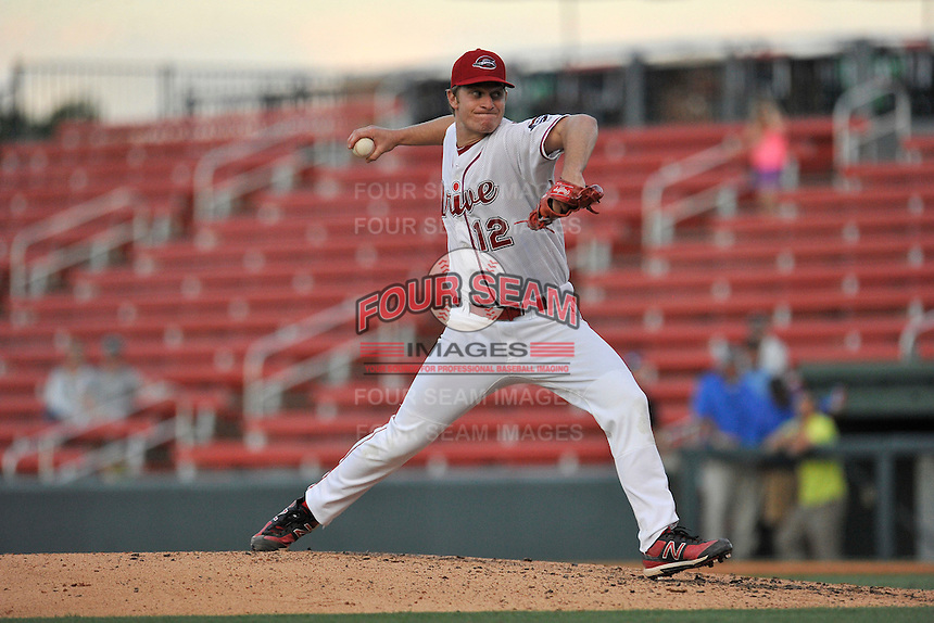 Starting pitcher Marc Brakeman (12) of the Greenville Drive delivers a pitch in a game against the Augusta GreenJackets on Wednesday, May 4, 2016, at Fluor Field at the West End in Greenville, South Carolina. Greenville won, 6-3. (Tom Priddy/Four Seam Images)