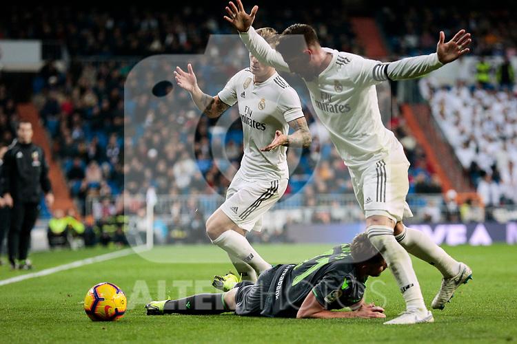 Real Madrid's Toni Kroos (L) and Sergio Ramos (R) and Real Sociedad's Adnan Januzaj during La Liga match between Real Madrid and Real Sociedad at Santiago Bernabeu Stadium in Madrid, Spain. January 06, 2019. (ALTERPHOTOS/A. Perez Meca)<br />  (ALTERPHOTOS/A. Perez Meca)
