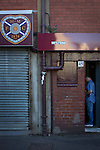 Heart of Midlothian 1 Birkirkara 2, 21/07/2016. Tynecastle Park, UEFA Europa League 2nd qualifying round. A home supporter paying in at a turnstile in the historic old main stand at Tynecastle Park, Edinburgh before Heart of Midlothian played Birkirkara of Malta in a UEFA Europa League 2nd qualifying round, second leg. The match ended in victory for the Maltese side by 2-1 and they progressed on aggregate after the first match had ended 0-0. The game was watched by 14301 spectators, including 56 visiting fans of Birkirkara. Photo by Colin McPherson.