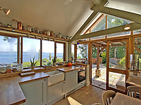 BNPS.co.uk (01202) 558833. <br /> Pic: LillicrapChilcott/BNPS<br /> <br /> Pictured: Kitchen. <br /> <br /> A pretty wooden cottage with spectacular panoramic sea views is on the market for £595,000.<br /> <br /> The aptly-named The Hut is an eco-built property set on a hill in the hugely sought-after Cornish village of Mousehole.<br /> <br /> The small but perfectly-formed home looks down over Mousehole harbour and across Mounts Bay to St Michael's Mount.