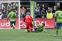 SEATTLE, WA - NOVEMBER 10: Kim Kee-hee #20 of the Seattle Sounders FC and Chris Mavinga #23 of Toronto FC collide while challenging for the ball during a game between Toronto FC and Seattle Sounders FC at CenturyLink Field on November 10, 2019 in Seattle, Washington.
