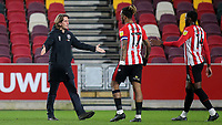 Brentford Manager Thomas Frank reaches out to Ivan Toney and Josh DaSilva at the final whistle after a fine 3-0 victory during Brentford vs Sheffield Wednesday, Sky Bet EFL Championship Football at the Brentford Community Stadium on 24th February 2021