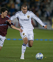Real Salt Lake forward Yura Movsisyan (white) pushes the ball past Colorado defender Kosuke Kimura. Real Salt Lake earned a tied versus the Colorado Rapids securing a place in the postseason. Dick's Sporting Goods Park, Denver, Colorado, October, 25, 2008. Photo by Trent Davol/isiphotos.com