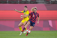 KASHIMA, JAPAN - AUGUST 5: Lindsey Horan #9 of the United States battles for the ball with Caitlin Foord #9 of Australia during a game between Australia and USWNT at Kashima Soccer Stadium on August 5, 2021 in Kashima, Japan.