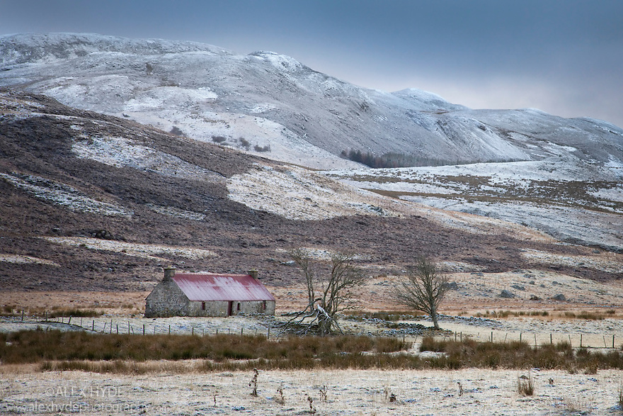 Old farm building in snowy scene, Strathnairn, Inverness-shire, Scotland, UK, November.