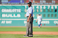 Umpire Kelvin Bultron during the International League game between the Charlotte Knights and the Durham Bulls at Durham Bulls Athletic Park on August 28, 2011 in Durham, North Carolina.   (Brian Westerholt / Four Seam Images)