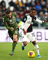Calcio, Serie A: Juventus - Cagliari, Turin, Allianz Stadium, January 6, 2020.<br /> Juventus' Douglas Costa (r) in action with Cagliari's Marko Rog (l) during the Italian Serie A football match between Juventus and Cagliari at Torino's Allianz stadium, on January 6, 2020.<br /> UPDATE IMAGES PRESS/Isabella Bonotto