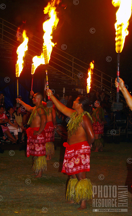 Spectators watch as torches are held aloft at a Polynesian show and luau in Kapiolani Park on the grounds of the original Kodak Hula Show in Waikiki.