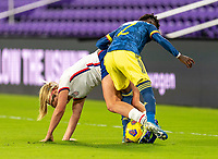 ORLANDO, FL - JANUARY 18: Lindsey Horan #9 of the USWNT fights for the ball with Kelly Ibarguen #2 of Colombia during a game between Colombia and USWNT at Exploria Stadium on January 18, 2021 in Orlando, Florida.