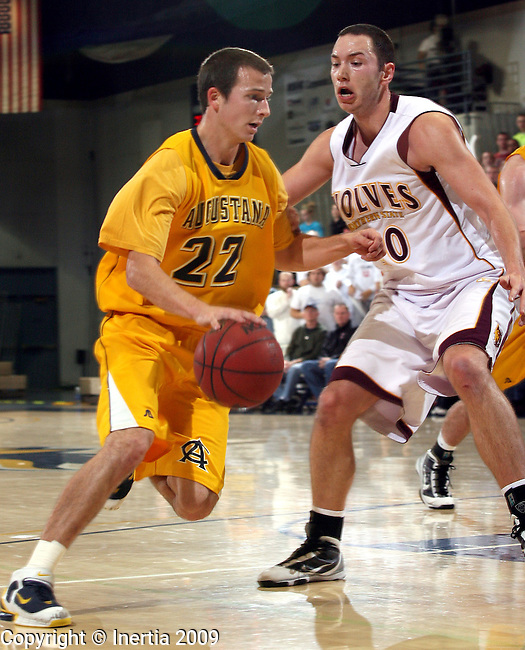 SIOUX FALLS, SD - DECEMBER 5:  Chad Hettermann #22 of Augustana tries to drive past Marko Filipovic #20 of Northern State in the first half of their NSIC game Saturday night at the Elmen Center.  (Photo by Dave Eggen/Inertia)