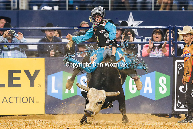 Junior bull riders in action during the Professional Bull Riders, Iron Cowboy V bull riding event, at the AT & T stadium in Arlington, Texas.