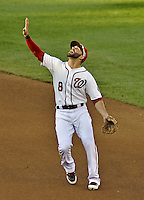 11 October 2012: Washington Nationals second baseman Danny Espinosa tracks an infield fly during Postseason Playoff Game 4 of the National League Divisional Series against the St. Louis Cardinals at Nationals Park in Washington, DC. The Nationals defeated the Cardinals 2-1 on a 9th inning, walk-off solo home run by Jayson Werth, tying the Series at 2 games apiece. Mandatory Credit: Ed Wolfstein Photo