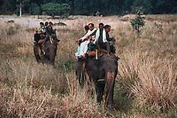People riding on back of Indian Elephant (Elephas maximus), Rajasthan, India
