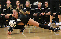 Katelyn Simpson (6) of Bentonville tries to save a kill  Thursday, Oct.  7, 2021, during play at Tiger Arena in Bentonville. Visit nwaonline.com/211008Daily/ for today's photo gallery.<br /> (Special to the NWA Democrat-Gazette/David Beach)