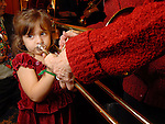 Ellie Maroisi,4, tries the trombone at the Houston Symphony League's annual Magical Musical Morning event at the Houstonian Saturday Dec. 12,2009.(Dave Rossman/For the Chronicle)