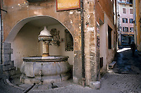 Water fountain dated ca. 1525 in the historical city of Briancon, French Alps, France.