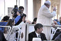 Pope Francis invites two children on his jeep.Pope Francis  during his weekly general audience in St. Peter square at the Vatican, Wednesday. February 18, 2015