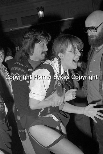 Richard Branson, Virgin Records company office party at The Venue Victoria London 1978. Gillan bassist, John McCoy in dark glasses.
