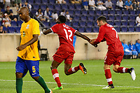 Harrison, NJ - Friday July 07, 2017: Alphonso Davies, Russell Teibert during a 2017 CONCACAF Gold Cup Group A match between the men's national teams of French Guiana (GUF) and Canada (CAN) at Red Bull Arena.