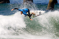 Aussie Blake Wilson banks of the top during round of 96 of the 2010 US Open of Surfing in Huntington Beach, California on August 4, 2010.