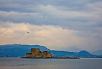 The island fortress of the Isle of Bourtzi is isolated against the Peloponnese sky, just north of the Nafplio harbour.