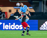 WASHINGTON, DC - APRIL 17: Maxime Chanot #4 of New York City FC goes up for a header with Erik Sorga #50 of D.C. United during a game between New York City FC and D.C. United at Audi Field on April 17, 2021 in Washington, DC.