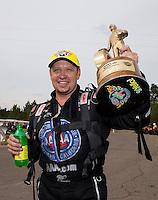 Mar 16, 2014; Gainesville, FL, USA; NHRA funny car driver Robert Hight celebrates after winning the Gatornationals at Gainesville Raceway Mandatory Credit: Mark J. Rebilas-USA TODAY Sports
