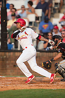 Edmundo Sosa (19) of the Johnson City Cardinals follows through on his swing against the Bristol Pirates at Howard Johnson Field at Cardinal Park on July 6, 2015 in Johnson City, Tennessee.  The Pirates defeated the Cardinals 2-0 in game one of a double-header. (Brian Westerholt/Four Seam Images)