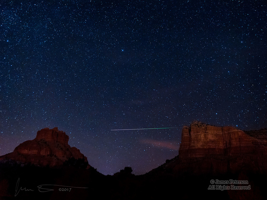 Leonid Meteor over Bell Rock Vista ©2017 James D Peterson.  During the 2017 peak of the Leonid Meteor Shower (Nov. 17-18), I went out around midnight for a two hour photography session.  I captured several meteors in that time, but this one was by far the best.  It moved from east to west (right to left in this image), and it's interesting to observe how the color of its glow changed as it penetrated farther into our atmosphere and ultimately vanished as the last of its mass vaporized.  Bell Rock is on the left, and Courthouse Butte is on the right, and Polaris (the North Star) is the bright star towards the top center.  The rocks are dimly lit by the lights of the Village of Oak Creek, where I live.