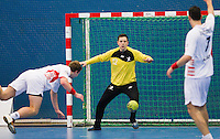 08 JAN 2012 - LONDON, GBR - Great Britain goalkeeper Bobby White (centre, in yellow and black) watches the ball during the men's 2013 World Handball Championships qualification match against Austria at the National Sports Centre in Crystal Palace, Great Britain .(PHOTO (C) 2012 NIGEL FARROW)