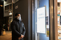 A man waiting outside the ER pharmacy. Only one person was allowed in at the time. Like most capitals, Oslo is usually busy on a Saturday night. But on the first weekend after Norwegian authorites  introduced measures to combat the Coronavirus (COVID-19) the city was almost deserted. <br /> <br /> Restriction on public gatherings, closure of schhols, new rules for those serving food and drinks, and fear of further spread of the virus compelled most bars and restaurants to close. Between 9 and midnight, normally a thriving time in the city centre, hardly any people ventures out. <br /> <br /> ©Fredrik Naumann/Felix Features