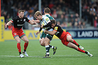 Mathew Tait of Leicester Tigers is tackled by Marcelo Bosch as Chris Ashton of Saracens supports during the Aviva Premiership semi final match between Saracens and Leicester Tigers at Allianz Park on Saturday 21st May 2016 (Photo: Rob Munro/Stewart Communications)