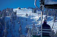 A chairlift and snow-covered trails at the Solitude Ski Area. Utah.