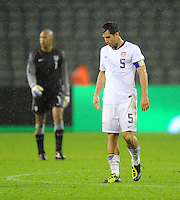 USA's Carlos Bocanegra (r) and goalkeeper Tim Howard react after the friendly match Belgium vs USA at King Baudoin stadium in Brussels, Belgium on September 06th, 2011.