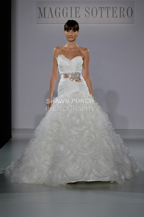 Model walks runway in a Jalissa wedding gown from the Maggie Sottero Spring 2013 collection, at The Couture Show, during New York Bridal Fashion Week, on October 14, 2012.