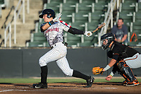 Mitch Roman (10) of the Kannapolis Intimidators follows through on his swing against the Delmarva Shorebirds at Kannapolis Intimidators Stadium on June 30, 2017 in Kannapolis, North Carolina.  The Shorebirds defeated the Intimidators 6-4.  (Brian Westerholt/Four Seam Images)