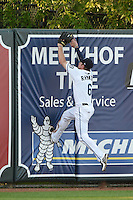 West Michigan Whitecaps outfielder Raph Rhymes (6) climbs the wall in an attempt to catch a home run during a game against the Great Lakes Loons on June 4, 2014 at Fifth Third Ballpark in Comstock Park, Michigan.  West Michigan defeated Great Lakes 4-1.  (Mike Janes/Four Seam Images)