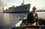 River Thames Waterman Michael Fletcher, docks, pilot guides a Roll on Roll off Ferry from Zeeburger into  Purfleet Thames Terminal,   Essex. Dartford Bridge background 1991