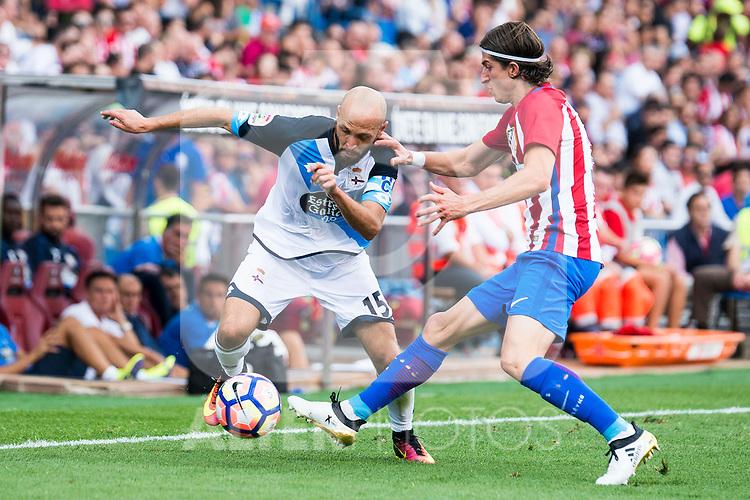 Atletico de Madrid's player Filipe Luis and Deportivo de la Coruña's player Laure during a match of La Liga Santander at Vicente Calderon Stadium in Madrid. September 25, Spain. 2016. (ALTERPHOTOS/BorjaB.Hojas)