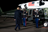 President Trump Travels to Georgia<br /> <br /> President Donald J. Trump salutes as he prepares to board Marine One at Dalton Municipal Airport in Dalton, Ga., Tuesday, Jan. 4, 2021, following his address at a rally at the airport. (Official White House Photo by Tia Dufour)