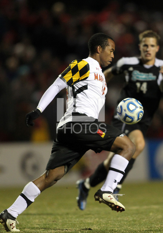 COLLEGE PARK, MD - NOVEMBER 25, 2012: Jordan Cyrus (14) of the University of Maryland guides the ball forward against Coastal Carolina University during an NCAA championship third round match at Ludwig Field, in College Park, MD, on November 25. Maryland won 5-1.