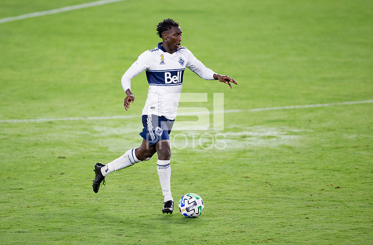 LOS ANGELES, CA - SEPTEMBER 23: Janio Bikel #19 of the Vancouver Whitecaps moves with the ball during a game between Vancouver Whitecaps and Los Angeles FC at Banc of California Stadium on September 23, 2020 in Los Angeles, California.