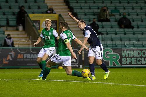 15th November 2020; Easter Road, Edinburgh, Scotland; Scottish League Cup Football, Hibernian versus Dundee FC; Paul Hanlon of Hibernian blocks a shot from Paul McGowan of Dundee