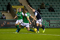 15th November 2020; Easter Road, Edinburgh, Scotland; Scottish League Cup Football, Hibernian versus Dundee FC; Paul Hanlon of Hibernian blocks a shot from Paul McGowan of Dundee
