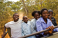 Children from grades 4 and 5 at Chalilo school in Sereje district, on their first safari in Kasanka National Park. Local schools and women's groups are regularly brought into Kasanka, which is unique in the country and unusual in Africa as it is privately managed and owned by a trust. People are able to see animals flourishing in land which was once free reign for poachers. Combined with anti-poaching scouts, the education programme is on the frontline of conservation methods in the park, showing local people wild animals in their natural habitat.