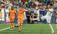 FOXBOROUGH, MA - JUNE 29: Tommy McNamara #11 passes the ball as Juan Agudelo #17 defends during a game between Houston Dynamo and New England Revolution at Gillette Stadium on June 29, 2019 in Foxborough, Massachusetts.